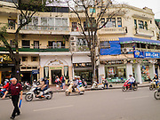31 MARCH 2012 - HANOI, VIETNAM:   Upscale shops and restaurants on Le Thai To Street across from Ho Hoan Kiem Lake in the Old Quarter of Hanoi, Vietnam. Vietnam is ostensibly a socialist country but the recent economic boom has seen large numbers of foreign owned businesses catering to wealthy Vietnamese and foreign tourists opening in the larger cities.   PHOTO BY JACK KURTZ