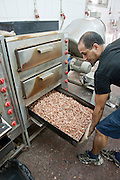 Peauts are being roasted at a small roasting oven