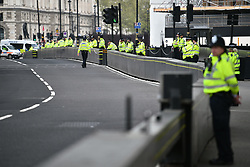 © Licensed to London News Pictures. 23/04/2019. London, UK. A large police presence at Parliament Square where Extinction Rebellion campaigners have gathered. The city wide protest which started eight days ago has now reduced in size to a smaller group after police arrested more than 1000 demonstrators as they blockaded major traffic intersections. Photo credit: Ben Cawthra/LNP