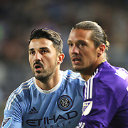 David Villa, NYCFC, is closely marked by Adrian Winter, Orlando, during the New York City FC Vs Orlando City, MSL regular season football match at Yankee Stadium, The Bronx, New York,  USA. 18th March 2016. Photo Tim Clayton