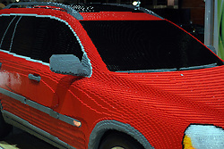 06 February 2005:  Model of a Volvo XC-90 built entirely from lego building blocks. <br /> <br /> The Volvo XC90 comes in two models, 2.5T and V8. The 2.5T comes with 17-inch alloy wheels, a power driver seat with memory, dual-zone automatic climate control, a CD player and 12 cupholders. A premium package adds leather upholstery, a moonroof, a power passenger seat, an in-dash CD changer and an auto-dimming mirror. In addition to this, the V8 model gets 18-inch wheels, body-colored door handles, aluminum interior trim and built-in, second-row child booster seats. Individual options include a DVD-based navigation system, bi-HID headlamps, parking sensors and a DVD entertainment system. A special Ocean Race Edition package is available on V8 models. It provides special blue paint, silver exterior moldings, upgraded leather upholstery and unique wood interior accents.<br /> <br /> First staged in 1901, the Chicago Auto Show is the largest auto show in North America and has been held more times than any other auto exposition on the continent.  It has been  presented by the Chicago Automobile Trade Association (CATA) since 1935.  It is held at McCormick Place, Chicago Illinois
