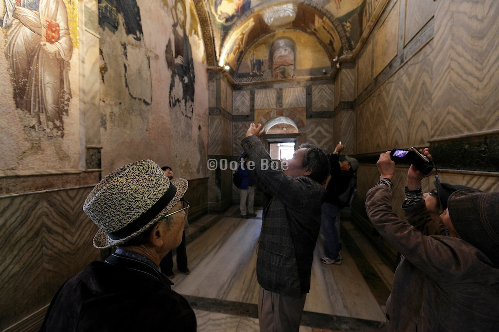 tourism photographing a mosaic inside the historical Chora church Istanbul Turkey