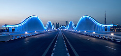 Illuminated bridge at Meydan in Dubai United Arab Emirates