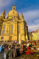 People at sidewalk cafes in the Neumarkt area with the Frauenkiche (church) in background, Dresden, Saxony, Germany