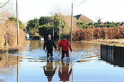 © Licensed to London News Pictures. 26/12/2013<br /> Local residents cut off from homes.<br /> Hampstead Lane Yalding in Kent near Yalding Level crossing is closed and flooded stopping residents getting into Yalding.<br /> The river Medway has Bursts its banks.<br /> Boxing day flooding in Kent.<br /> Large parts of Kent are still flooded due to heavy rain with more bad weather expected.<br /> Photo credit :Grant Falvey/LNP