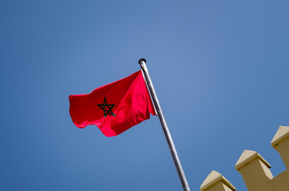 FEZ, MOROCCO - CIRCA APRIL 2017:  Moroccan flag in Fez over a blue sky.