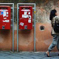 TAORMINA, SICILY: A woman walks past a postbox in the town of Taormina.