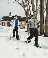 Jeanne and Dave Bockus of Tilton ventured out for a snowshoe hike through the trails at Prescott Farm during Winter Fest on Saturday afternoon.   (Karen Bobotas/for the Laconia Daily Sun)