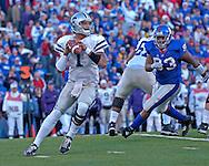 Kansas State quarterback Josh Freeman (1) drops back to pass against Kansas at Memorial Stadium in Lawrence, Kansas, November 18, 2006.  Kansas beat K-State 39-20.<br />