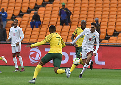 South Africa: Johannesburg: Bafana Bafana players Lebohang Maboe(L) and Sandile Hlanti(R) battle for the ball with Seychelles player Karl Hopprich during the Africa Cup Of Nations qualifiers at FNB stadium, Gauteng.<br />Picture: Itumeleng English/African News Agency (ANA)