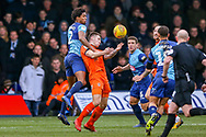 Wycombe Wanderers defender Sido Jombati climbs over Luton Town forward James Collins to get to the ball during the EFL Sky Bet League 1 match between Luton Town and Wycombe Wanderers at Kenilworth Road, Luton, England on 9 February 2019.
