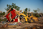 Bulldozers begin the razing of the Belville camp in New Belgrade. The residents of the community had been relocated earlier in the day.