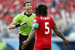 (l-r) referee Ghead Grisha, Roman Torres of Panama during the 2018 FIFA World Cup Russia group G match between England and Panama at the Nizhny Novgorod stadium on June 24, 2018 in Nizhny Novgorod, Russia