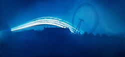 © licensed to London News Pictures. London, UK. World Pinhole Day 24th April 2011. Solargraph pinhole photograph of the London Eye. Using just an Empty film canister loaded with a single pieces of photosensitive paper and a hole the size of a pin these remarkable photographs of some of London's landmarks have been captured after months of patience. The canisters are left placed pointed at their subjects in secret locations around the capital. The hole is so small that only a tiny amount of light hits the paper meaning the exposure can last months, allowing for fantastic light trails to be left by the sun and moon.  Please see special instructions for usage rates. Photo credit should read Marcia Petterson/LNP