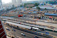 China, Beijing, Chaoyang, San Jian Fang, 2008. An Chaoyang Street area undergoing simultaneous construction and demolition. Street widening in this working-class area has brought protests against eviction without compensation..