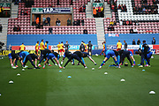 The teams start their warm up during the EFL Sky Bet Championship match between Wigan Athletic and Nottingham Forest at the DW Stadium, Wigan, England on 20 October 2019.