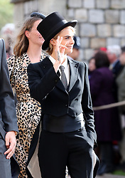 Cara Delevingne arrives ahead of the wedding of Princess Eugenie to Jack Brooksbank at St George's Chapel in Windsor Castle.