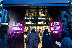 © Licensed to London News Pictures. 28/11/2019. LONDON, UK. Shoppers enter the House of Fraser department store which is promoting discounts in Oxford Street, the capital's busiest shopping area, on the eve of Black Friday.  The US phenomenon of discounts for Thanksgiving has now been adopted by many retailers in the UK with several offering discounts during the prior week, instead of on the day itself.  Critics question whether some discounts offered on the day are cheaper than at other times.  Photo credit: Stephen Chung/LNP