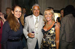 Left to right, ISABEL GOLDSMITH and MR & MRS DAVID MORRIS he is the jewelle at a party to celebrate the re-opening of the David Morris Flagship store at 180 New Bond Street, London on 14th June 2006.<br /><br />NON EXCLUSIVE - WORLD RIGHTS