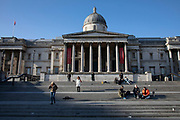 Trafalgar Square and the National Gallery empty and almost deserted due to the Covid-19 outbreak social distancing on what would normally be a busy, bustling day with hoards of people out to shop and socialise on 22nd March 2020 in London, England, United Kingdom. Coronavirus or Covid-19 is a new respiratory illness that has not previously been seen in humans. While much or Europe has been placed into lockdown, the UK government has announced more stringent rules as part of their long term strategy, and in particular social distancing.