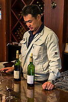 Sommelier at  & Wine Tasting Room - Yamanashi is the birthplace of Japanese wine. A young man raised in Katsunuma was dispatched to France in 1870  to learn techniques in winemaking and from these beginnings many wineries were established in Katsunuma.  Since the 1870s, wineries in Koshu and Katsunuma have continued to refine their product to cultivate some fairly impressive wines.  In just the Katsunuma area alone, one can find well over 200 winemakers.  Katsunuma has a unique climate that is natural for viticulture because of the soil and climate.  Most wineries have their own caves for aging the wines, and others use a disused railway tunnel with a perfect conditions for storing wine that is rented out.  This gives the wines the needed time to age wines slowly.  At first they are aged in French oak barrels, and at the opportune moment they are bottled.  Many of the wineries, including Grace, Chateau Katsunuma and Kurambon among the finest in the region, have tasting rooms and tours of their vineyards.