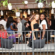 Kirby Akindeinde @kirbyanne & Zaynah Onye attend the Oppo party to launch its new Madagascan Vanilla, Sicilian Lemon and Raspberry Cheesecakes, served with Skinny Prosecco at Farm Girls Café, 1 Carnaby Street, Soho, London, UK on July 18 2018.
