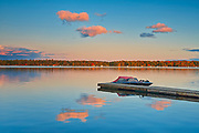 Dock and boats on Silent Lake at sunset<br />Silent Lake Provincial Park<br />Ontario<br />Canada