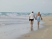 couple walking along the beach Miami Beach USA