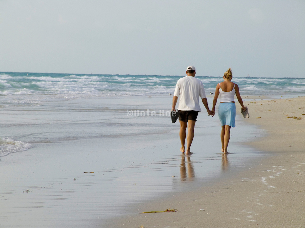 couple walking along the beach Miami Beach USA