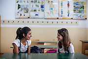 Two students at Frumuşani's local school. Its 700 students are evenly split between Roma and non-Roma students. Two programs, School after School and Equal Opportunities in Education offer mentoring, homework clubs and overall extra support in Math and Romanian – two core subjects in the national test which determine if children can progress to high school.