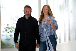 Fashion designer duo Justin Thornton and Thea Bregazzi greet the audience after their Preen by Thornton Bregazzi London Fashion Week SS18 show held at QEII Centre, London