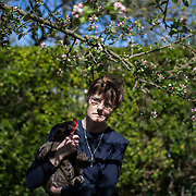 Hermit Sister Rachel Denton poses for a portrait with her chicken in St Cuthberts' Hermitage in Lincolnshire, north east Britain April 27, 2015. Sister Rachel Denton has vowed to spend the rest of her life living as a consecrated hermit in the Catholic faith. A hermit is a person who chooses to live alone, with the intention of finding God. Rarely leaving her house she lives a life of prayer and solitude. However, she uses the internet and social media to share her experience and distance her self from physically interacting with society. REUTERS/Neil Hall