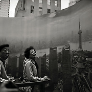 """Woman viewing a 360 degree panorama of the city of Shanghai in Midtown Manhattan.  Taken from the series """"Down with the Ship"""""""
