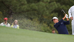 April 7, 2018 - Augusta, GA, USA - Rickie Fowler hits from a fairway bunker on the 1st hole during the third round of the Masters Tournament on Saturday, April 7, 2018, at Augusta National Golf Club in Augusta, Ga. (Credit Image: © Jason Getz/TNS via ZUMA Wire)