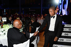 Left to right, SAMUEL L JACKSON and PHARRELL WILLIAMS at the GQ Men of The Year Awards 2013 in association with Hugo Boss held at the Royal Opera House, London on 3rd September 2013.