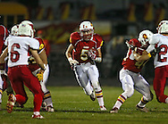 Marion's Tyler Gunderson (5) on a run during the first half of the game between Maquoketa and Marion at Thomas Park Field in Marion on Friday, September 21, 2012.