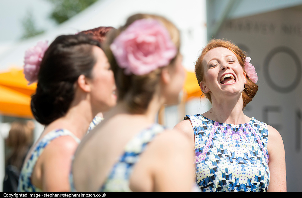 © Licensed to London News Pictures. 06/06/2014. Epsom, UK. The Duke Box Singers entertain the racegoers.  Ladies Day today 6th June 2012 at Epsom 2014 Investic Derby Festival in Surrey. Traditionally, elegant, fashionable racegoers gather for a classic day's racing at Epsom Racecourse, Surrey. Photo credit : Stephen Simpson/LNP