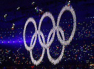BEIJING, CHINA: The Olympic rings are lifted in the air inside the National Stadium during the 2008 Olympiad Opening Ceremony in Beijing, China on Friday, 8/8/08. Thousands of athletes from all over the world marched in the stadium representing their various countries and thousands of Chinese dancers were used to create the performance..©2008 Johnny Crawford