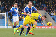 Chesterfield defender Ian Evatt uses his strength as he battles for possession during the EFL Sky Bet League 1 match between Chesterfield and Oxford United at the Proact stadium, Chesterfield, England on 25 February 2017. Photo by Aaron  Lupton.