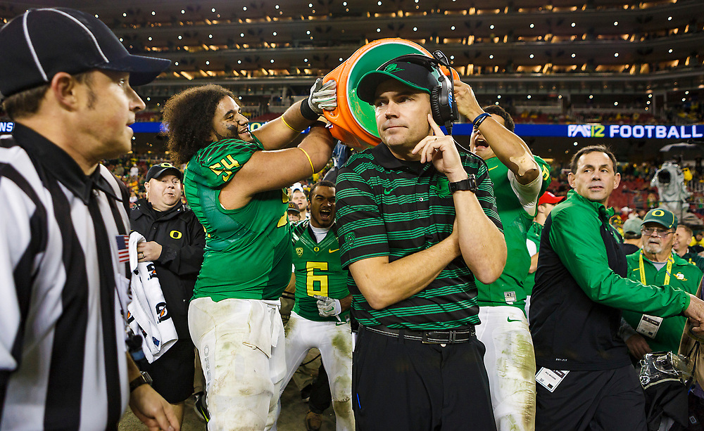 The Oregon Ducks pour water over Oregon head coach Mark Helfrich after winning the football game. The No. 2 Oregon Ducks play the No. 7 Arizona Wildcats in the Pac-12 Championship at Levi's Stadium in Santa Clara, California on December 5, 2014. (Ryan Kang/Emerald)