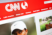 Computer screen showing the website for US online news service, CNN. Tiger Woods is in the news.