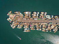 Aerial view of wooden boats in Dubai Dhow Wharfage harbour, UAE.