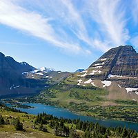 View from top of Logan Pass in Glacier National Park.<br /> Clouds stream from the peak.