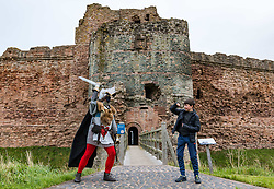North Berwick, East Lothian, Scotland, UK, Tantallon Castle reopening: Historic Environment Scotland reopens more of their properties today including this 14th century Medieval curtain wall clifftop castle which overlooks the Firth of Forth. Andrew Spratt, HES custodian and Medieval enthusiast welcomes the first visitors, dressed appropriately as a knight in Medieval armour with a face mask, including Zac, aged 12 years, who is on holiday from England. <br /> Sally Anderson | EdinburghElitemedia.co.uk