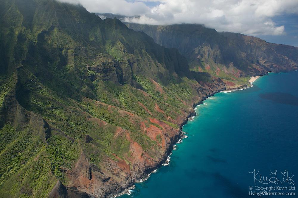 Dozens of narrow canyons meet the Pacific Ocean along the Na Pali coast of Kaua`i, Hawai`i.