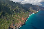 Dozens of narrow canyons meet the Pacific Ocean along the Na Pali coast of Kaua`i, Hawai`i.