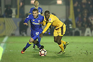 AFC Wimbledon midfielder Dean Parrett (18) battles for possesion with Sutton United midfielder Bedsente Gomis (8) during the The FA Cup third round replay match between AFC Wimbledon and Sutton United at the Cherry Red Records Stadium, Kingston, England on 17 January 2017. Photo by Matthew Redman.