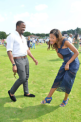 CHIKÉ OKONKWO  and NAOMIE HARRIS at The Royal Salute Coronation Cup Polo held at Guards Polo Club,  Smiths Lawn, Windsor Great Park, Egham on 23rd July 2016.