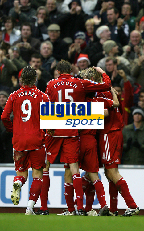 Photo: Paul Greenwood/Sportsbeat Images.<br />Liverpool v Bolton Wanderers. The FA Barclays Premiership. 02/12/2007.<br />Liverpool's Sami Hypia (hidden) is mobbed by team mates after he opens the scoring