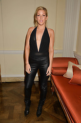 ELLIE GOULDING at a party hosed by the US Ambassador to the UK Matthew Barzun, his wife Brooke Barzun and editor of UK Vogue Alexandra Shulman in association with J Crew to celebrate London Fashion Week held at Winfield House, Regent's Park, London on 16th September 2014.